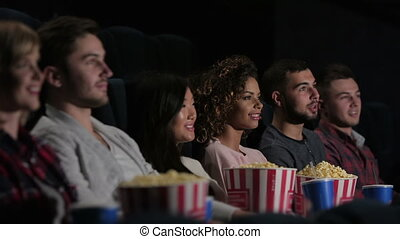 Friends in cinema watching a movie