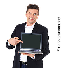 Attractive middle-aged man pointing on notebook computer. All on white background.