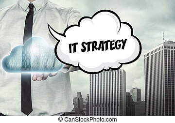 IT strategy text on cloud computing theme with businessman on cityscape background