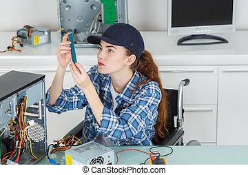 it technician holding a computer part