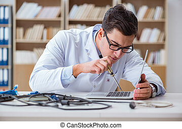 IT technician repairing broken laptop notebook computer