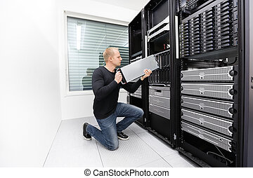 It technician replace blade server in datacenter - It...
