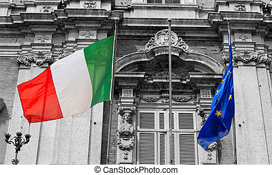 italian and european flags on a balcony of the italian army academy waving in the wind