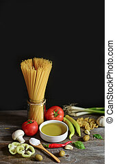 Italian and Mediterranean food ingredients on old wooden background, close-up