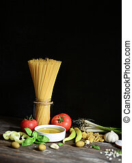Italian and Mediterranean food ingredients on old wooden background.