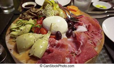 Italian antipasto dried ham, cheese