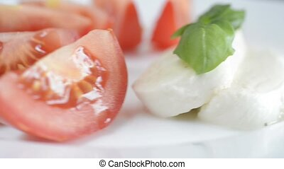 Italian appetizer tomatoes with mozarella and basil on a...
