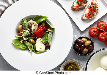 Italian basil salad and traditional bruschetta