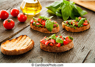 Italian bruschetta with chopped vegetables, herbs and oil on...