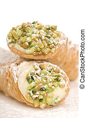 Delicious Italian Cannoli with pistachio nuts and powdered sugar