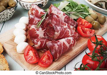 Italian capicola, cured pork meat - Slices of italian...