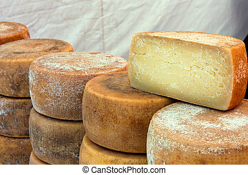 italian cheese - heap of italian seasoned cheese - market of...