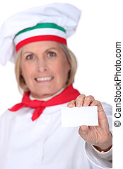 Italian chef with a blank business card