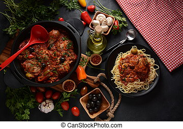 Italian chicken Cacciatore hunter's stew with spaghetti noodles