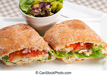 ciabatta panini sandwich with chicken and tomato - italian...