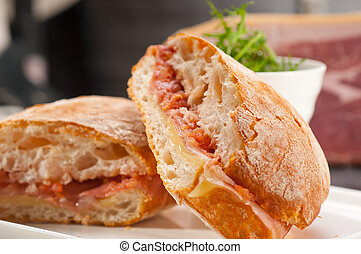 ciabatta panini sandwich with parma ham and tomato - Italian...