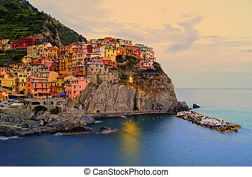Italian coastal village at sunset - Village of Manarola, ...