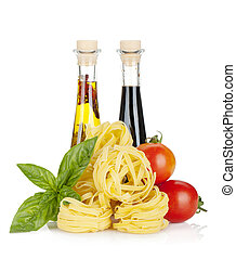 Italian colors food. Basil, pasta, tomatoes, olive oil and ...