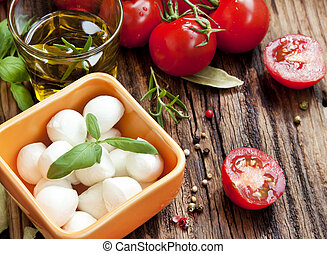 Fresh Mediterranean Ingredients, Mozzarella, Basil, Olive Oil, Tomatoes and Spices for Italian Cooking Recipe