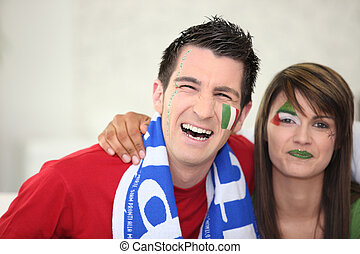 Italian couple going to watch a soccer game