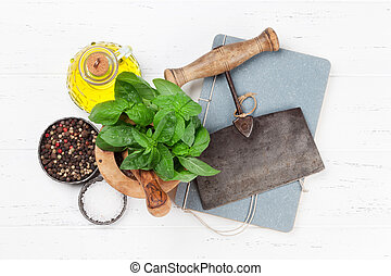 Italian cuisine. Basil, olive oil and spices cooking. Top view with space for your recipe