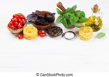 Italian cuisine. Basil, pasta and tomato cooking. With space...