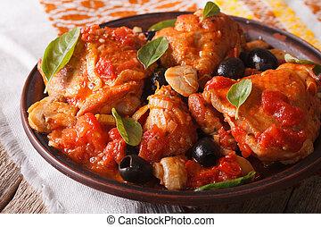 Italian cuisine: Cacciatori chicken with mushrooms closeup. ...