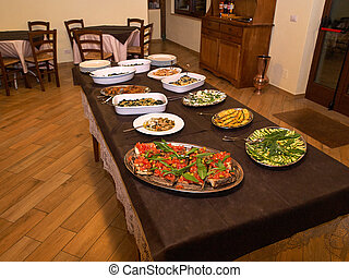 Italian cuisine dinner served in a traditional restaurant Italy
