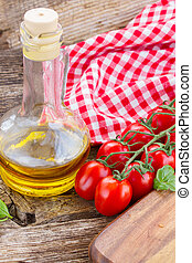 italian cuisine - olive oil with tomatoes