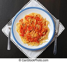 Italian cuisine, spinach and salmon fish tomato sauce pasta