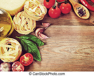 Italian cuisine. Vegetables, oil, spices and pasta on the table.