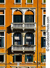 Italian culture on Venetian facades. Venice is rich and poor, well-groomed and abandoned, reflected in its windows.