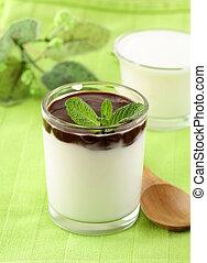 Italian dairy dessert Panacotta in a glass beaker