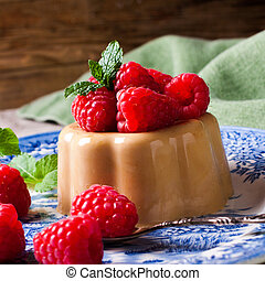 Italian dessert coffee panna cotta served on a blue plate...