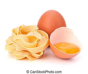 Italian egg pasta fettuccine nest isolated on white...