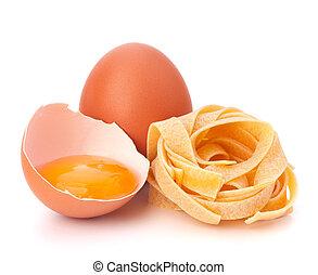 Italian egg pasta fettuccine nest isolated on white ...