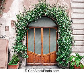 Italian elegant door with plants decorations