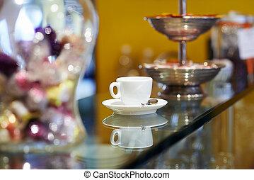 italian espresso coffee cup on counter in cafeteria