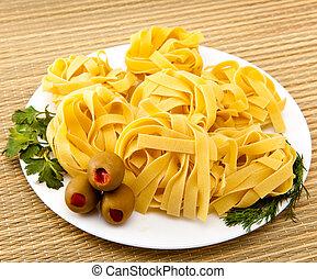 Italian fettuccine nest pasta on a plate