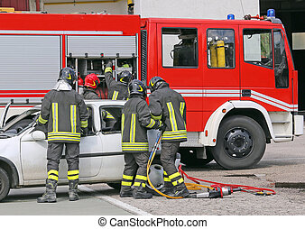 italian firefighters relieve an injured after a road accident