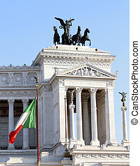 Italian flag and monument Vittoriano in Rome