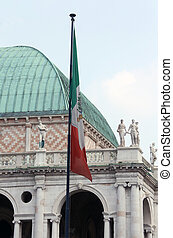 italian flag and the palladian Basilica in vicenza Italy -...