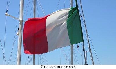 Italian flag at sail boat mast