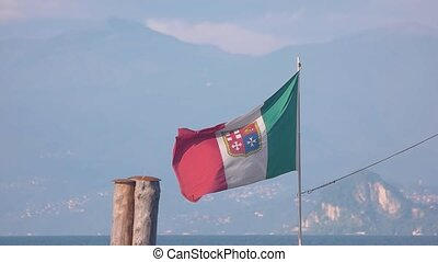 Italian flag on scenic background. Flag in the wind. Culture...