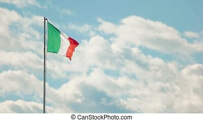 Italian flag on sky background. Flag in the wind, slow-mo....
