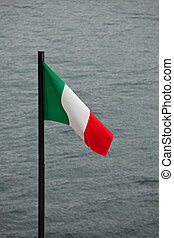 italian flag with a lake in the background