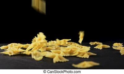 Italian flying raw pasta - Italian raw pasta flying on black...