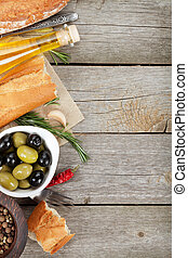 Italian food appetizer of olives, bread, olive oil and ...