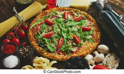 Italian food background with pizza, raw pasta and vegetables...