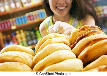 italian food - customer in a supermarket buying a slice of ...
